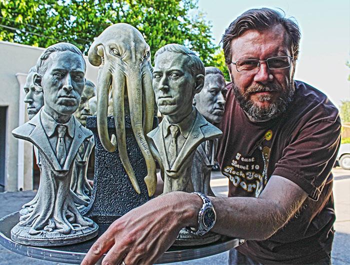 Lee Joyner with his H.P. Lovecraft sculptures