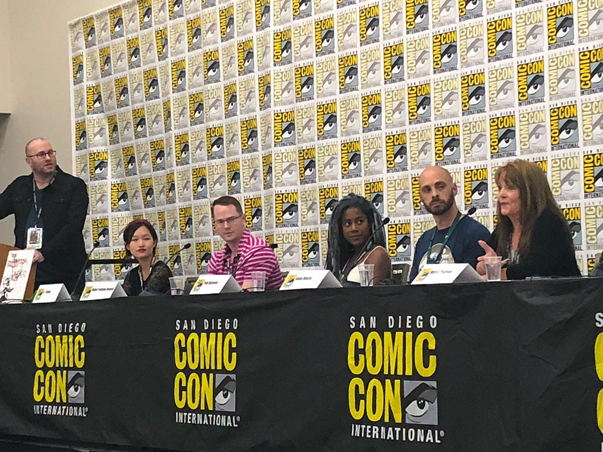 Adron Buske moderating the Here They Be Dragons panel at San Diego Comic Con 2018.